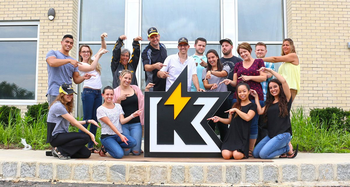 Kickcharge team surrounding Kickcharge K sign