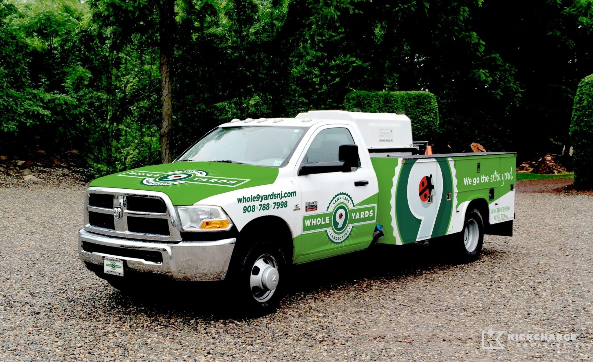 Vehicle wrap design for Whole 9 Yards Lawn Care and Landscaping serving Flemington, New Jersey.