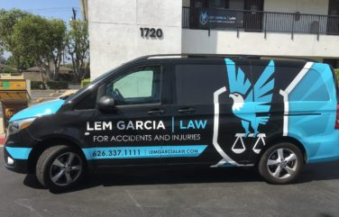 Vehicle wrap design for Lem Garcia Law, a California-based law firm.